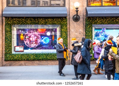NEW YORK CITY - DECEMBER 7, 2018:  Christmas in New York street scene from Macy's Department Store at Herald Square in Manhattan with holiday window displays and people.