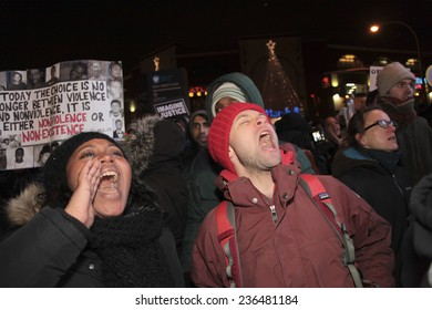 """NEW YORK CITY - DECEMBER 8 2014: several hundred protesters staged a """"shut it down!"""" rally at Barclay's Center against police brutality which coincided with a visit by the Duke & Duchess of Cambridge"""
