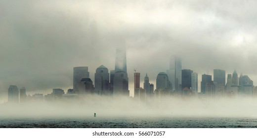 New York City downtown business district panorama in a foggy day