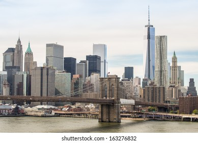 New York City downtown financial district skyline with Brooklyn Bridge on East River