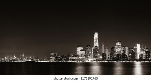 New York City downtown skyline at night panorama over Hudson River