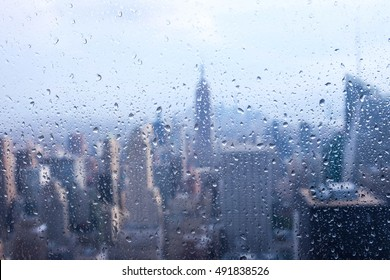 New York city : Empire State Building window view with the rain outside, Manhatta, USA