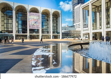 NEW YORK CITY -  FEB. 10, 2014: The Lincoln Center Plaza in New York City.  Lincoln Center is home to the Metropolitan Opera, NYC Ballet, NY Philharmonic, Avery Fisher Hall and the Juilliard School.