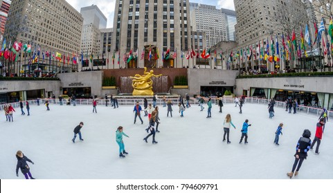 NEW YORK CITY - FEB 10: Locals and tourists watch and do ice skating at one of the most traditional tourist attractions of New York city, the Rockefeller Center Compound on February 10, 2012.