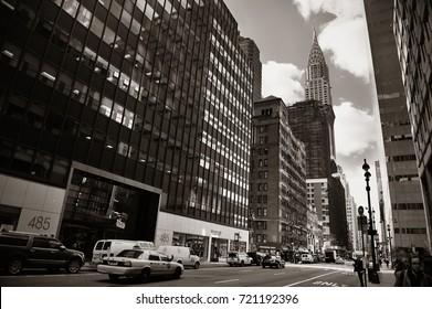 NEW YORK CITY - FEB 19: Street view with skyscrapers on February 19, 2014 in Manhattan, New York City. With population of 8.4M, it is the most populous city in the United States.