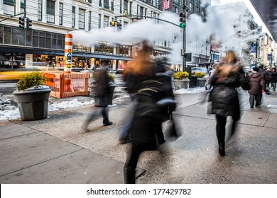 NEW YORK CITY - FEB. 7, 2014: Blur of pedestrians in motions during morning rush hour in midtown Manhattan.
