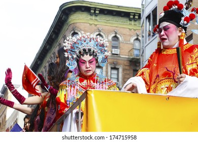 NEW YORK CITY - FEBRUARY 2 2014: Chinese Lunar New Year, the Year of the Horse, was celebrated by a parade in Manhattan's Chinatown. Women in vintage courtly attire ride along Mott Street