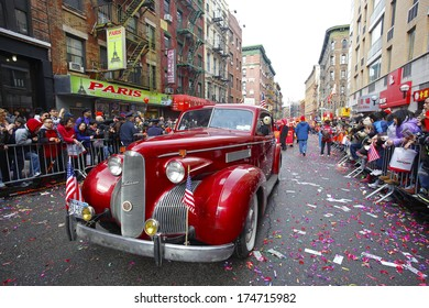 NEW YORK CITY - FEBRUARY 2 2014: Chinese Lunar New Year, the Year of the Horse, was celebrated by a parade in Manhattan's Chinatown. Vintage LaSalle sedan makes its way along Mott Street.