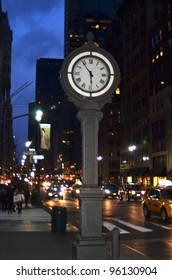 NEW YORK CITY - FEBRUARY 25: The historic clock at 5th avenue at dusk with old buildings in background February 25, 2012 in New York, NY.