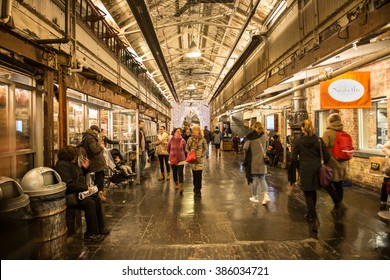 NEW YORK CITY - FEBRUARY 27: People on shopping at Chelsea Market urban food court, shopping mall, office building and television production facility on February 27, 2016 in New York City, USA
