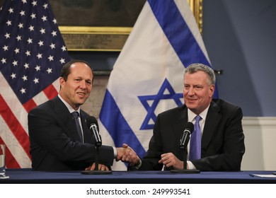 NEW YORK CITY - FEBRUARY 4 2015: Jerusalem mayor Nir Barkat, visiting NYC as part of an Israeli trade delegation, was hosted at City Hall by mayor Bill De Blasio where they held a press conference.