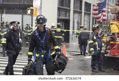 NEW YORK CITY - FEBRUARY 5 2016: A crawler crane in the process of being secured against high winds collapsed on Worth St, injuring several & killing one person.