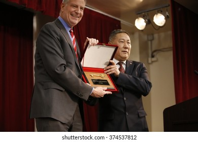 NEW YORK CITY - FEBRUARY 8 2016: day one of the Chinese Lunar New Year was marked by a fireworks ceremony, honors to Mayor de Blasio & thousands of confetti cannon. Mayor de Blasio & key to Chinatown