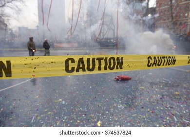 NEW YORK CITY - FEBRUARY 8 2016: day one of the Chinese Lunar New Year was marked by a fireworks ceremony, honors to Mayor de Blasio & thousands of confetti cannon. Caution tape in front of fireworks
