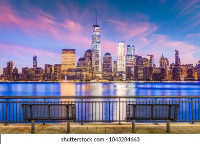 New York City financial district on the Hudson River at twilight.