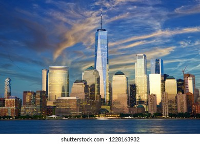 New York City financial district over Hudson River at dusk