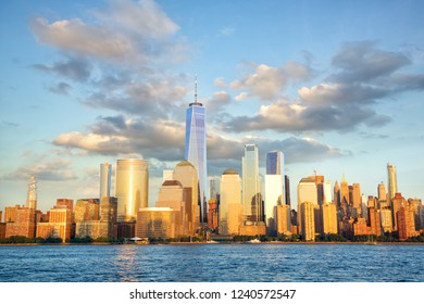 New York City financial district over Hudson River at sunset