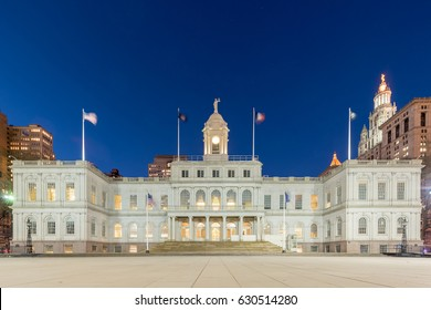 New York City Hall at night, the seat of New York City government, located at the center of City Hall Park in the Civic Center area of Lower Manhattan, between Broadway, Park Row, and Chambers Street.