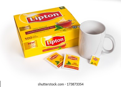 NEW YORK CITY - JAN. 21, 2014:  Box of Lipton Tea with teabags and cup on white background. The Lipton Brand was named after its founder Thomas Lipton.