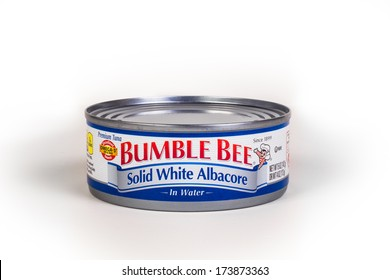NEW YORK CITY - JAN. 21, 2014:  Single can of Bumble Bee tuna fish on white background. The Bumble Bee Company produces canned tuna, salmon, other seafoods, and chicken and introduced in 1910.