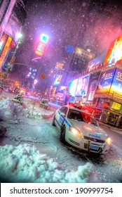 NEW YORK CITY - JAN 27: NYPD police car during first snowfall of the year in Times Square, New York City on Jan 27, 2011.