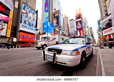 NEW YORK CITY - JAN 6: Empty Times Square in morning with NYPD car in foreground, January 6, 2011 in Manhattan, New York City.