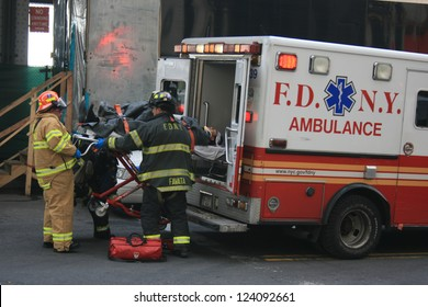 NEW YORK CITY - JAN 9: Person injured in a ferry accident at Pier 11 is put into an ambulance in Lower Manhattan on January 9, 2013 in New York City, NY.
