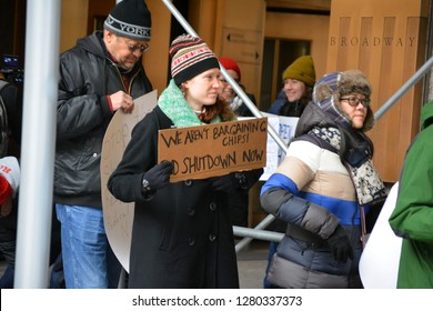 New York City - January 10, 2019: People protesting the ongoing government shutdown in front of a federal building in Lower Manhattan.