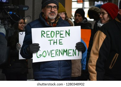 New York City - January 10, 2019: People protesting the government shutdown in front of a Federal Building in Lower Manhattan.