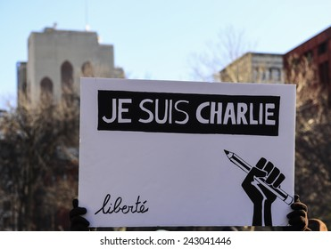 NEW YORK CITY - JANUARY 10 2015: several hundred people gathered in Washington Square Park for a moment of silence to express solidarity for the victims of the Charlie Hebdo attacks in Paris