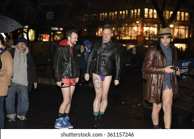 NEW YORK CITY - JANUARY 10 2015: Improv Everywhere's 15th annual No Pants Subway Ride, New York, took place in unseasonably warm temperatures and intermittent rain.