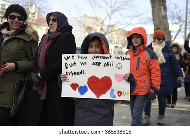"NEW YORK CITY - JANUARY 18 2015: Brooklyn residents gathered in Bay Ridge at the site of an anti-Muslim bias attack for a march entitled ""Muslims Our Neighbors""."