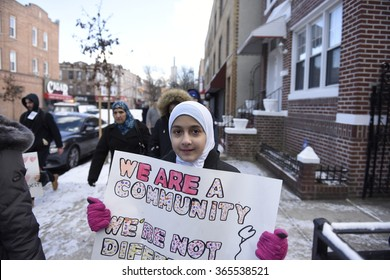 """NEW YORK CITY - JANUARY 18 2015: Brooklyn residents gathered in Bay Ridge at the site of an anti-Muslim bias attack for a march entitled """"Muslims Our Neighbors""""."""