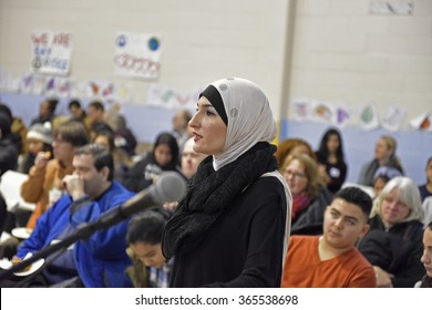 """NEW YORK CITY - JANUARY 18 2015: Brooklyn residents gathered in Bay Ridge at the site of an anti-Muslim bias attack for a march entitled """"Muslims Our Neighbors"""". Linda Sarsour of the Arab American Ass"""