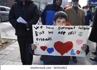 """NEW YORK CITY - JANUARY 18 2015: Hundreds of Brooklyn residents gathered in Bay Ridge at the site of an alleged bias attack for a march entitled """"Muslims Our Neighbors"""". Maujd Taube with sign."""