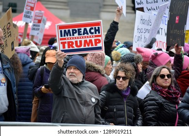 New York City, January 19, 2019: Signs held at the Women's Unity March in Foley Square in Lower Manhattan.