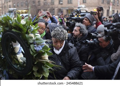 NEW YORK CITY - JANUARY 19 2015: Rev Al Sharpton, accompanied by Eric Garner's family, placed wreaths on the site where NYPD officers Wenjian Liu & Rafael Ramos were slain. Gwen Carr passing wreath