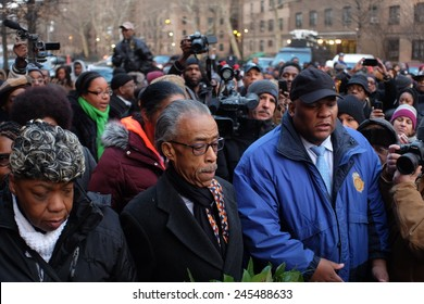 NEW YORK CITY - JANUARY 19 2015: Rev Al Sharpton, accompanied by Eric Garner's family, placed wreaths on the site where NYPD officers Wenjian Liu & Rafael Ramos were slain. Moment of silence