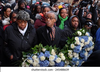 NEW YORK CITY - JANUARY 19 2015: Rev Al Sharpton, accompanied by Eric Garner's family, placed wreaths on the site where NYPD officers Wenjian Liu & Rafael Ramos were slain. Rev Sharpton & Gwen Carr