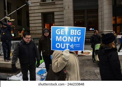 NEW YORK CITY - JANUARY 21 2015: several dozen activists gathered on Broad St by the NYSE to demonstrate in favor of campaign finance reform & play life-size Monopoly. Common Cause sign