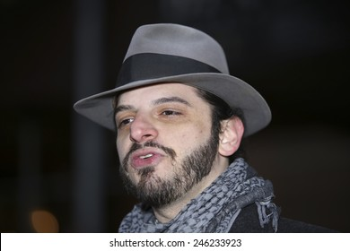 NEW YORK CITY - JANUARY 21 2015: several dozen activists gathered on Broad St by the NYSE to demonstrate in favor of campaign finance reform & play life-size Monopoly. Organizer Casper Snyder speaks
