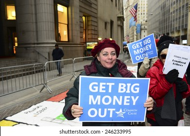 NEW YORK CITY - JANUARY 21 2015: several dozen activists gathered on Broad St by the NYSE to demonstrate in favor of campaign finance reform & play life-size Monopoly.