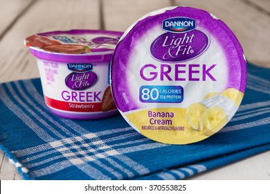 NEW YORK CITY - JANUARY 22, 2016:  Two container cups of Dannon Light and Fit, low calorie, flavored  Greek yogurt.