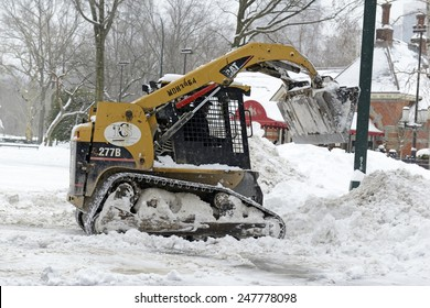 NEW YORK CITY - JANUARY 27, 2015. While snowfall was much less than originally forecasted, the streets of New York City were filled with construction equipment removing snow all day after the storm.