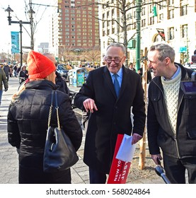 NEW YORK CITY - JANUARY 29 2017: Thousands protested President Trump's immigration ban with a rally in Battery Park & march to Foley Square. Senior US senator Charles Schumer