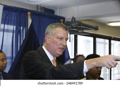 NEW YORK CITY - JANUARY 30 2015: Mayor De Blasio conducted a tour of & held a press conference at Van Dyke's Jobs-Center to announce a new director of the Young Men's Initiative. Fielding questions