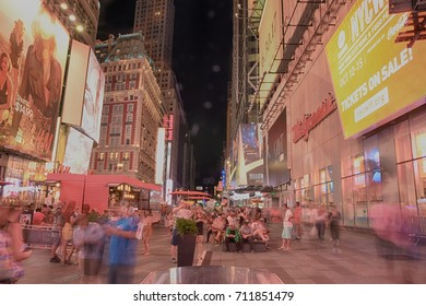 New York City - July 02, 2017: New York Times square  street traffic and crowded by many people. image was photographed with slow shutter speed to add ghost effect of walking people in times square.