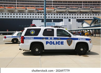 NEW YORK CITY - JULY 1: Port Authority Police New York New Jersey K-9 unit providing security for Queen Mary 2 cruise ship docked at Brooklyn Cruise Terminal on July 1, 2014