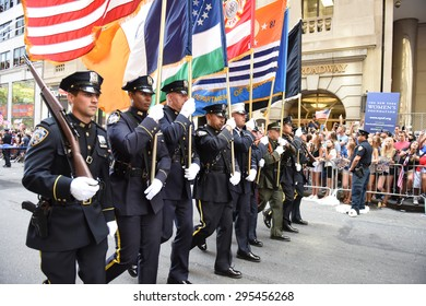 NEW YORK CITY - JULY 11 2015: a ticker tape parade was held for the champion US women's FIFA team along Canyon of Heroes on Broadway. NYPD color guard leads parade