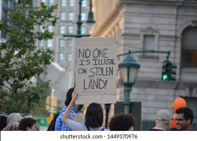 "New York City - July 12, 2019: People taking part in the ""Lights4Liberty"" protests against President Trump's planned ICE raids against immigrants and the detention centers along the southern border."